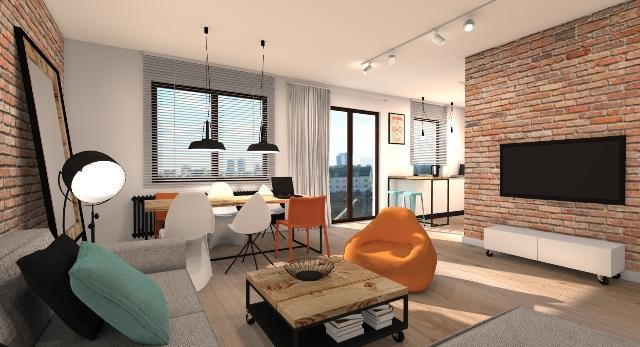 Loft z odcieniem pomarańczu projektu Widawscy Studio Architektury
