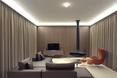 Salon - willa Moerkensheide w De Pinte w Belgii autorstwa Dieter De Vos Architecten