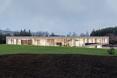 Elewacja frontowa bryły The Slight Slope Long House w Bułgarii, autorstwa I/O Architects