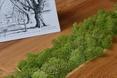 Mech uzupełania drewnianą bryłę. Stolik Malita Just Wood